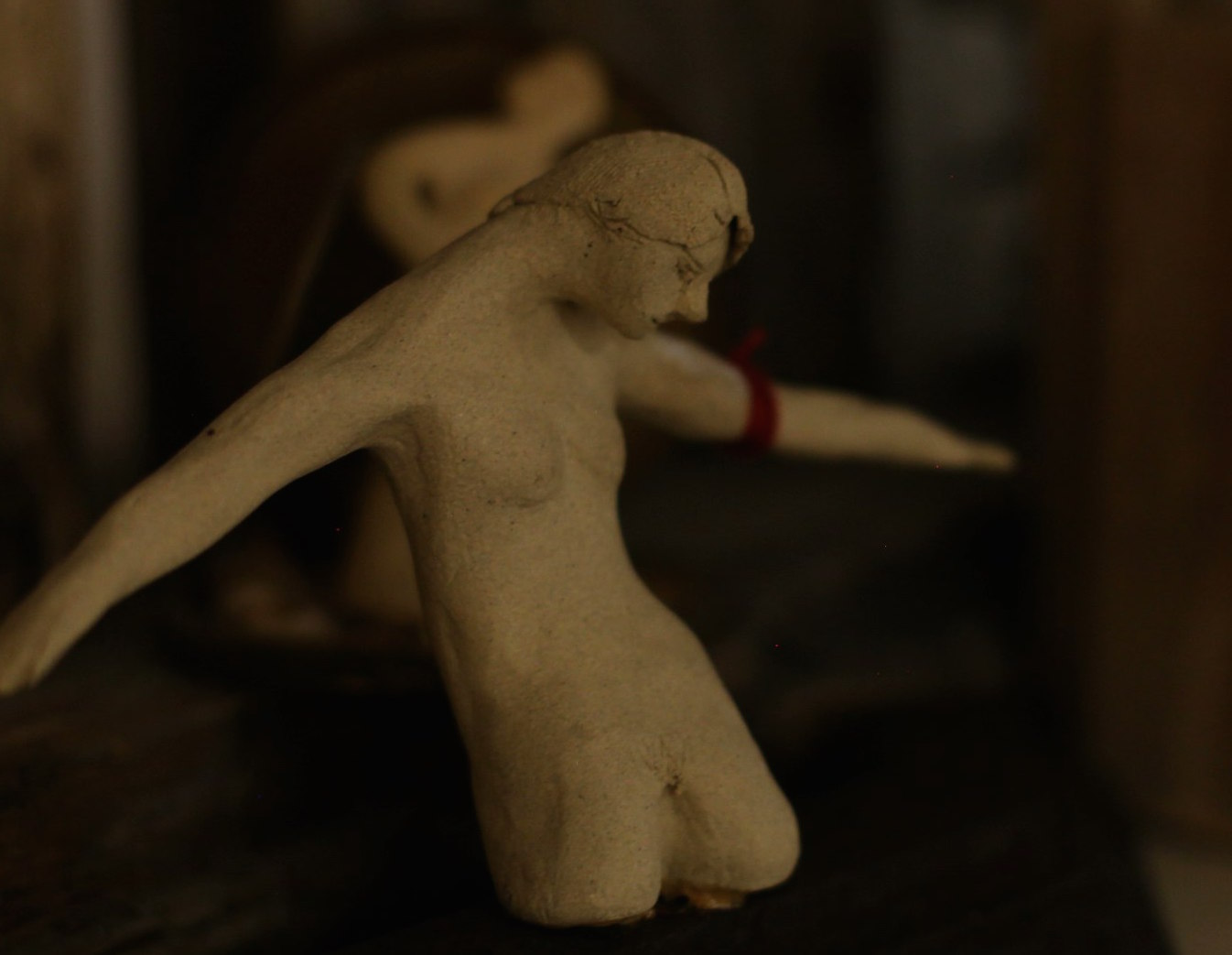 close up of a small fragmented ceramic figure