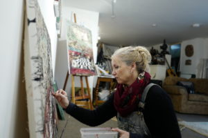 photo of the artist painting in her studio by Rick Davey