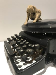 sculpture from old typewriter and small ceramic figure