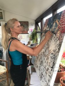 the artist painting at home