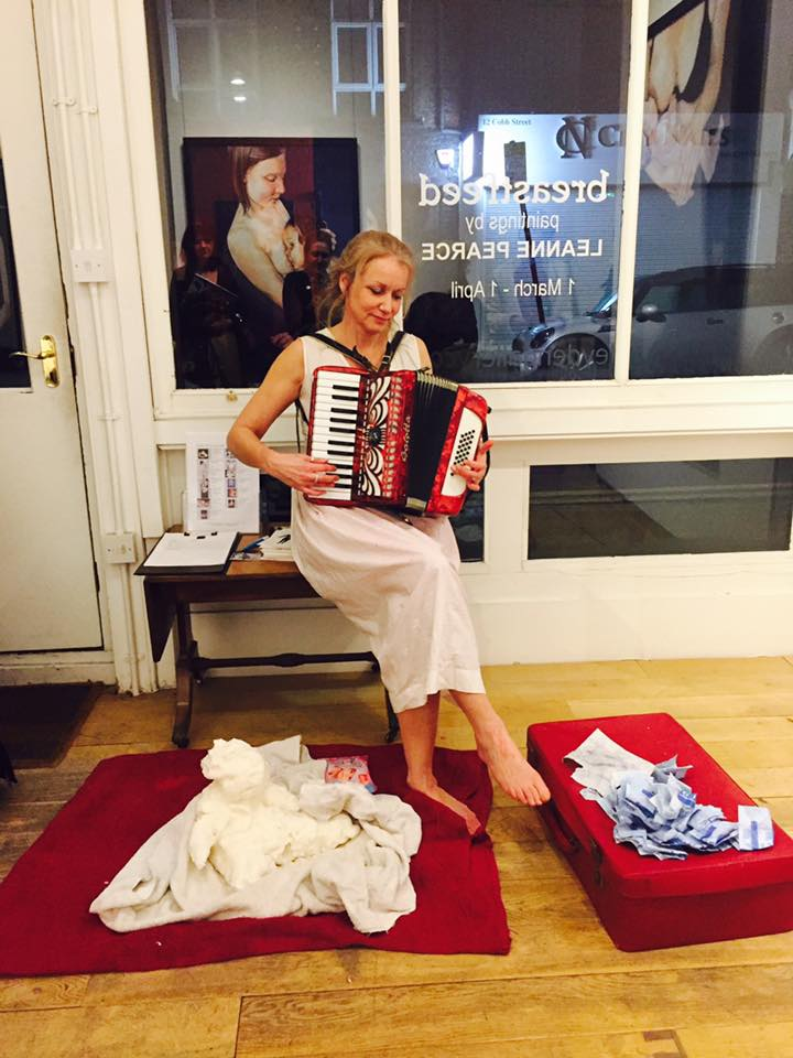 photo of artist playing accordion