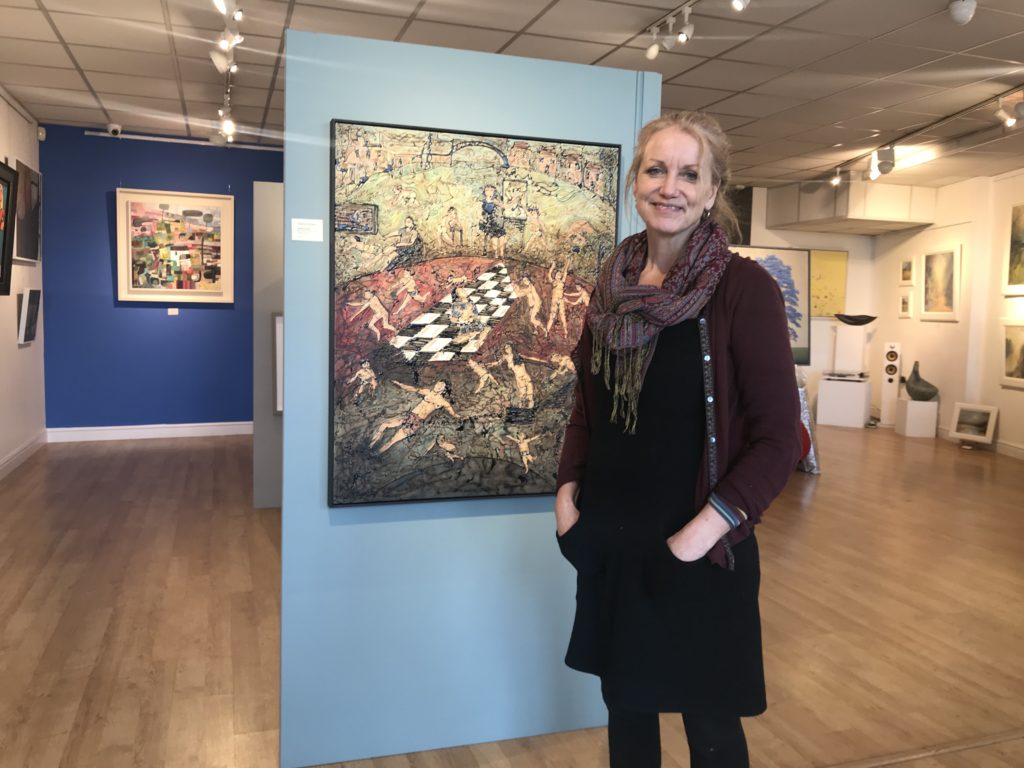 photo of artist with work at clifton gallery